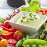 Mayo-Free Avocado Green Goddess Dressing and Dip surrounded by fresh vegetables.