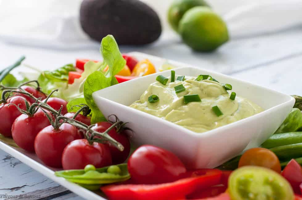 Mayo-Free Avocado Green Goddess Dressing and Dip surrounded by fresh veggies