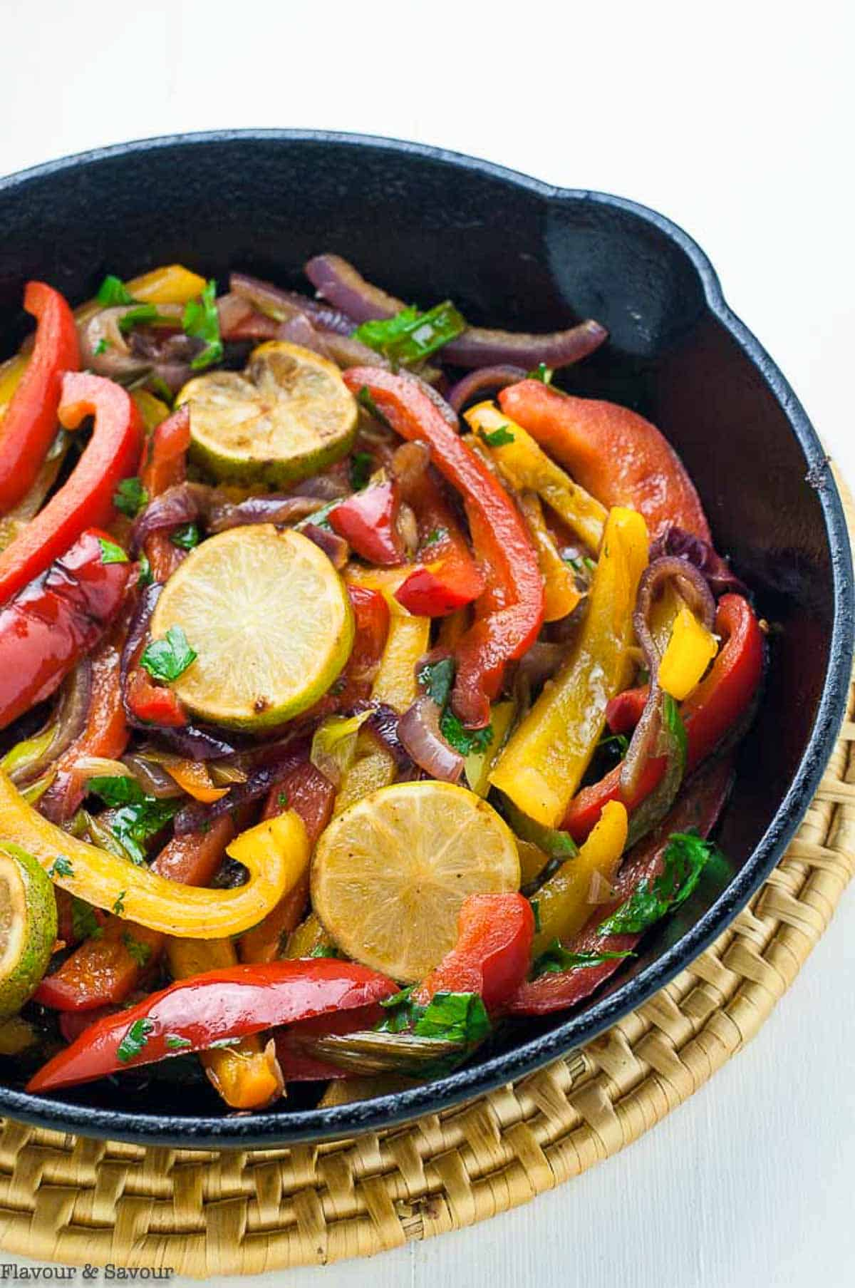 Sautéed peppers and onions in a cast iron pan for Fajita Salad