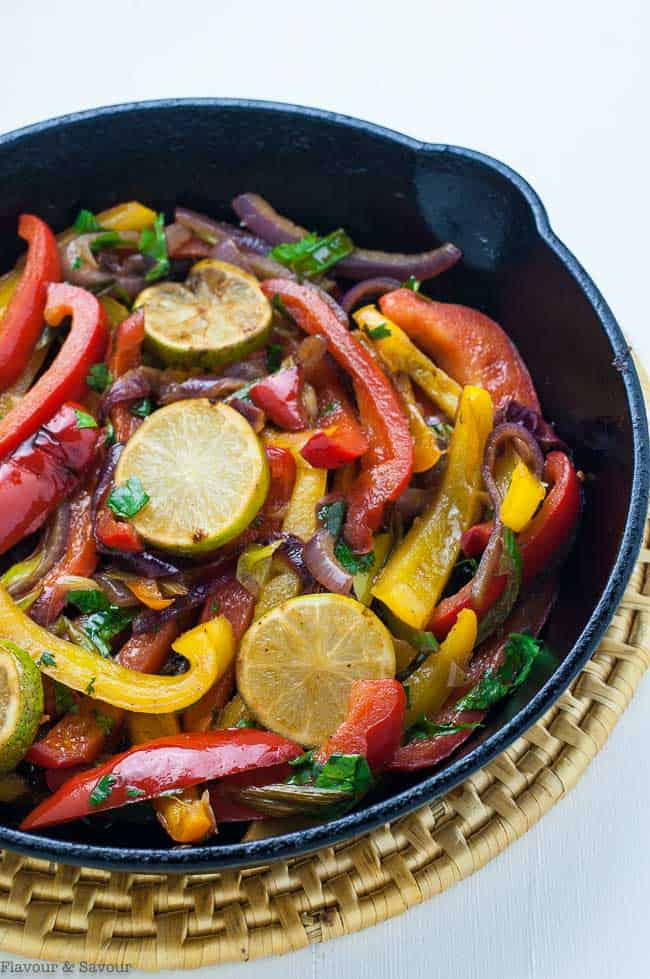 peppers and onions in a cast iron skillet