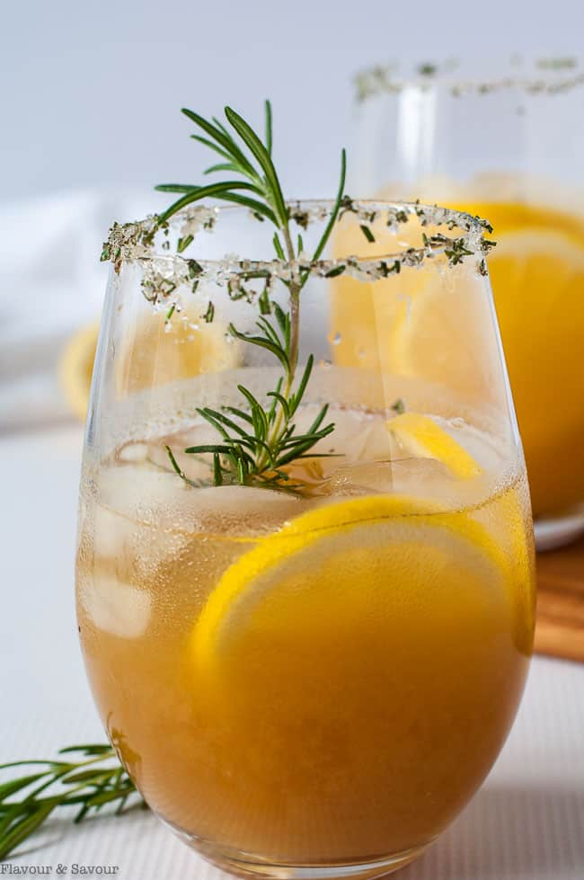 Close up view of PIneapple Ginger Kombucha Cocktail with Rosemary