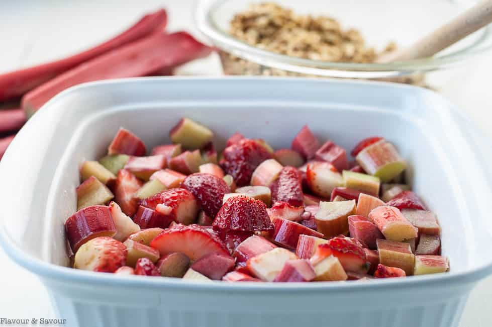 Strawberries and rhubarb and a bowl of crisp topping for Gran Marnier Strawberry Rhubarb Crisp