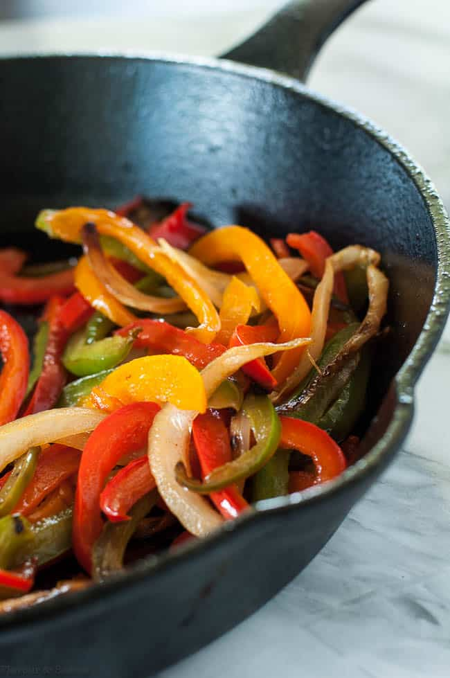 Sautéed peppers and onions for Paleo Chicken Fajita Burgers with Tomatillo Guacamole