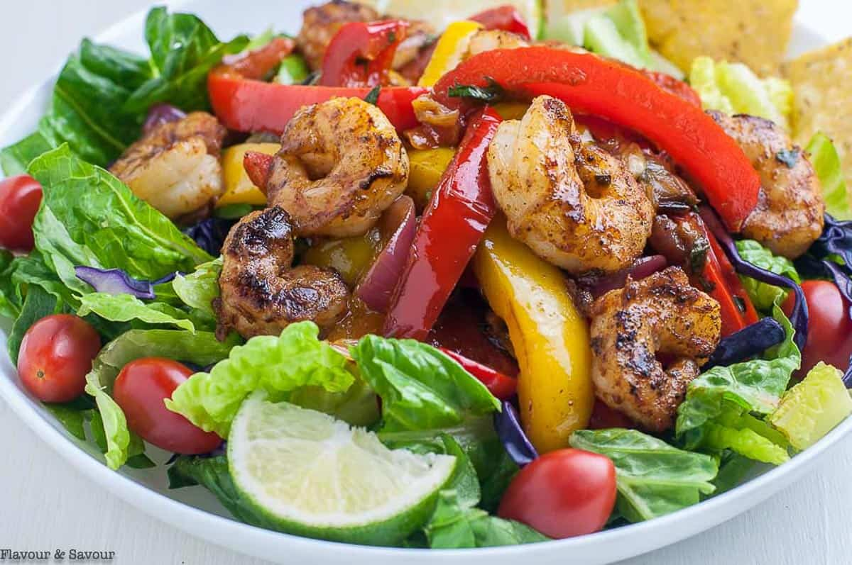 close up view of shrimp and peppers in a fajita salad