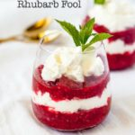 Easy Raspberry Rhubarb Fool layered in a dessert glass with mint