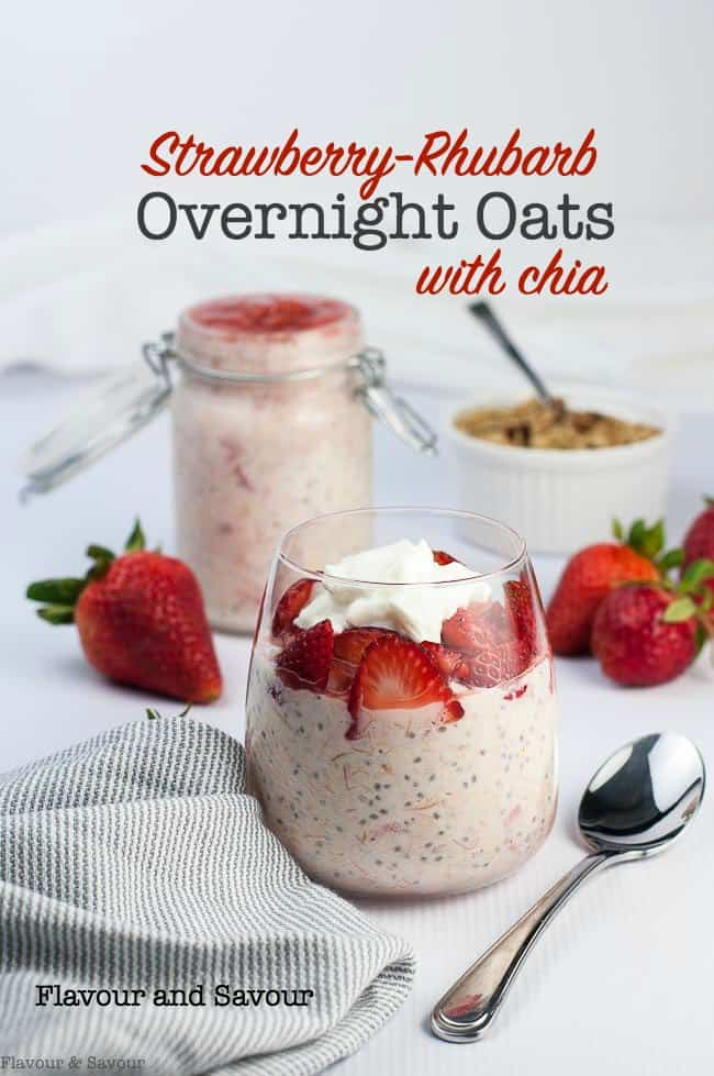 Creamy Strawberry Rhubarb Chia Overnight Oats in a glass, garnished with fresh strawberries and yogurt