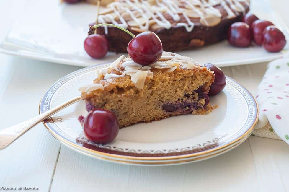 Close up view of a slice of Flourless Cherry Almond Ricotta Cake