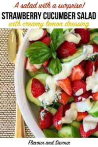 Strawberry Cucumber Salad with Creamy Lemon Dressing garnished with basil