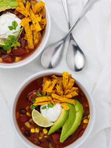 Slow Cooker Vegetarian Texas Black Bean Soup overhead view of 2 bowls