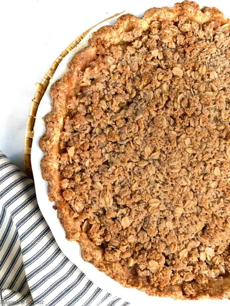 Overhead view of a baked apple pie with a crumble crust