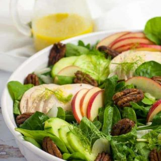 Fennel Apple Chicken Salad with a a jug of dressing