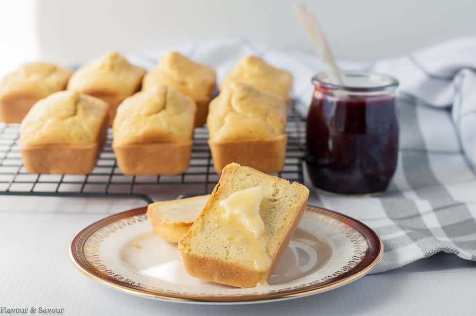 Super Easy Low-Carb Keto Mini Buns on a cooling rack served with butter and chia jam