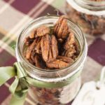 Close up view of a Mason jar gift of Low-Carb Pumpkin Spice Roasted Pecans