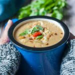 Holding a warm mug of Slow Cooke Moroccan Harissa Cauliflower Soup