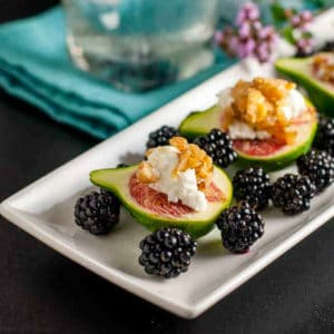 Fresh figs with goat cheese served with fresh blackberries