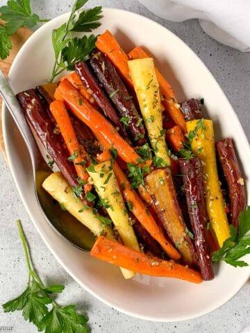 a bowl of roasted rainbow carrots
