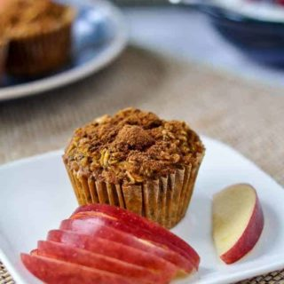 Cranberry Apple Pumpkin Baked Oatmeal cup with apple slices