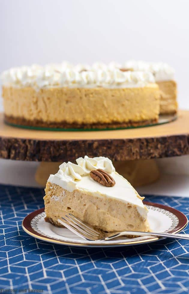 Creamy Gluten-Free Pumpkin Cheesecake on a plate with a fork.