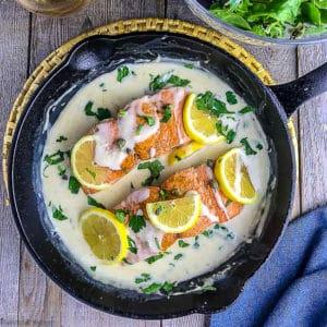 Creamy Lemon Salmon Piccata in a cast iron pan