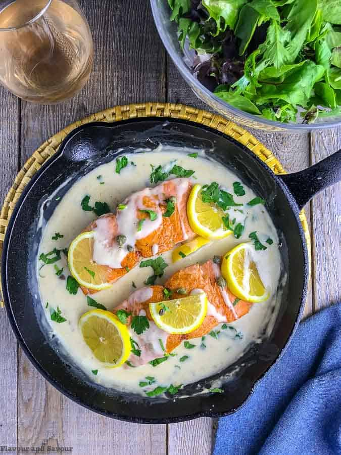 30-minute Creamy Lemon Salmon PIccata in cast iron skillet