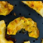 Garlic Parmesan-Crusted Roasted Acorn Squash title