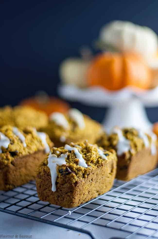 Loaves of Mini Gluten Free Pumpkin Bread on a cooling rack