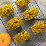 MIni Gluten-Free Pumpkin Loaves on cooling rack with pumpkins