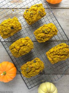 MIni Gluten-Free Pumpkin Loaves on cooling rack with pumpkins