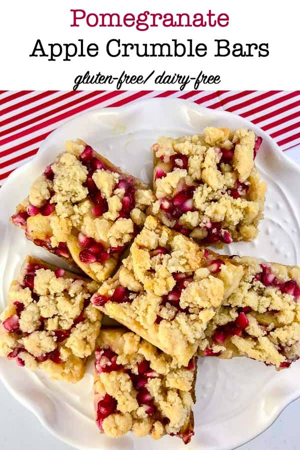 Paleo Pomegranate Apple Crumble Bars on a plate with a red and white striped napkin