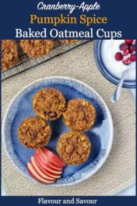Overhead view of Baked Oatmeal cups with apple slices and yogurt with cranberries