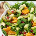 Kiwi Mandarin Spinach Salad with Creamy Avocado Dressing title