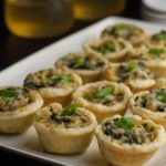 Mini Spinach Artichoke Tarts on a white platter