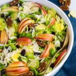 Overhead view of Shaved Brussels Sprout Salad with sliced apples