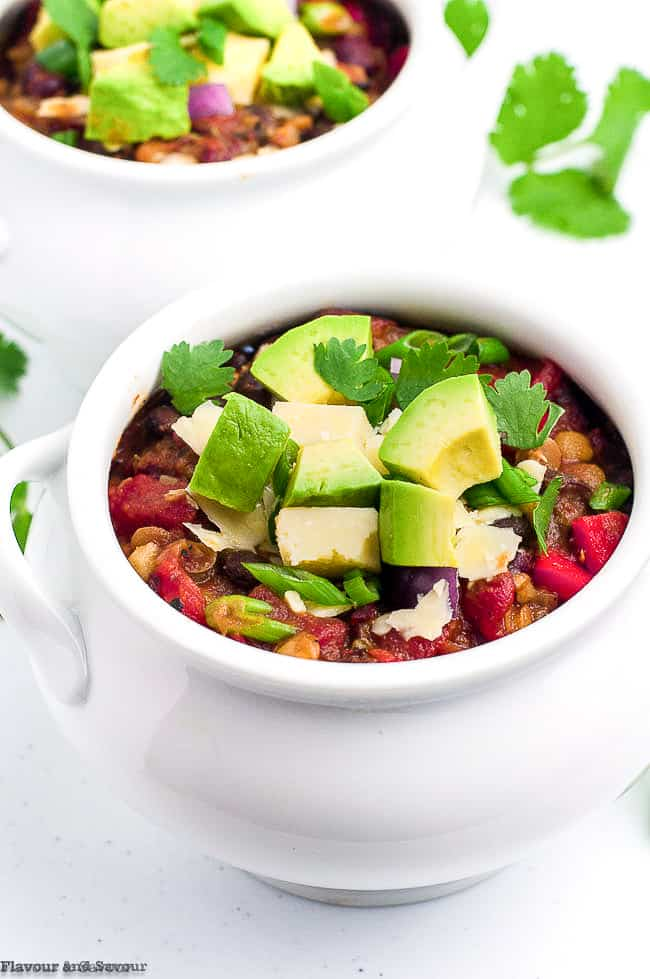 A bowl of Instant Pot vegan chili with avocado cubes
