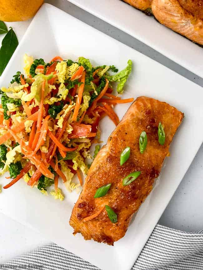 Easy Citrus Glazed Bake Salmon with Sake close up served with coleslaw