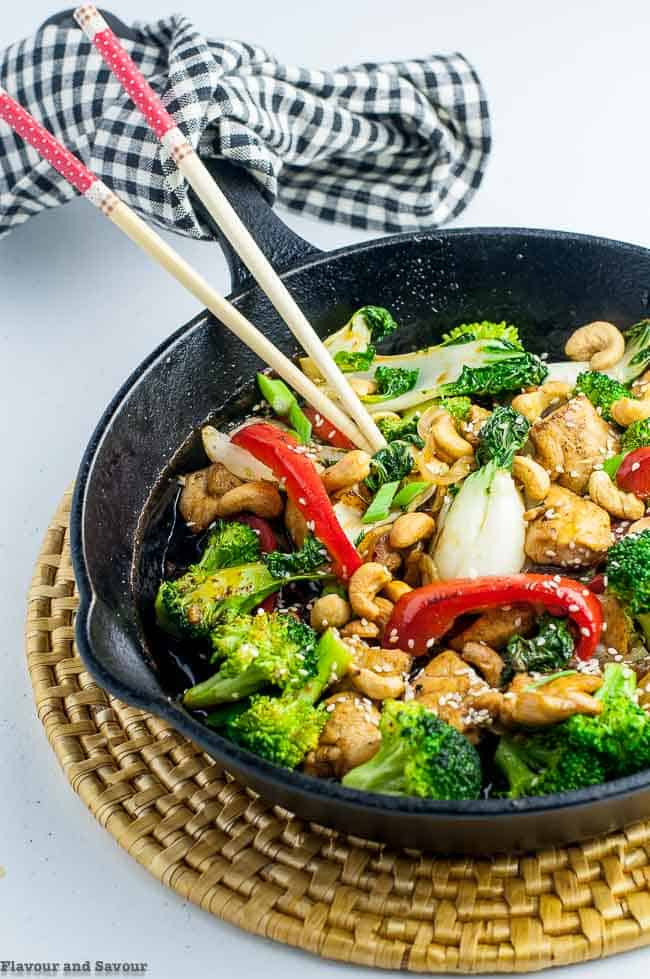 Japanese Chicken Stir Fry in cast iron pan with chopsticks