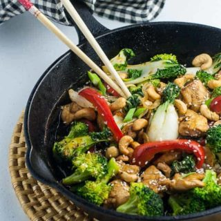 Japanese Chicken Stir Fry in Cast iron fry pan with chopsticks
