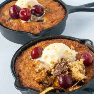 Gluten-Free Cherry Chocolate Skillet Cookie with ice cream and cherries