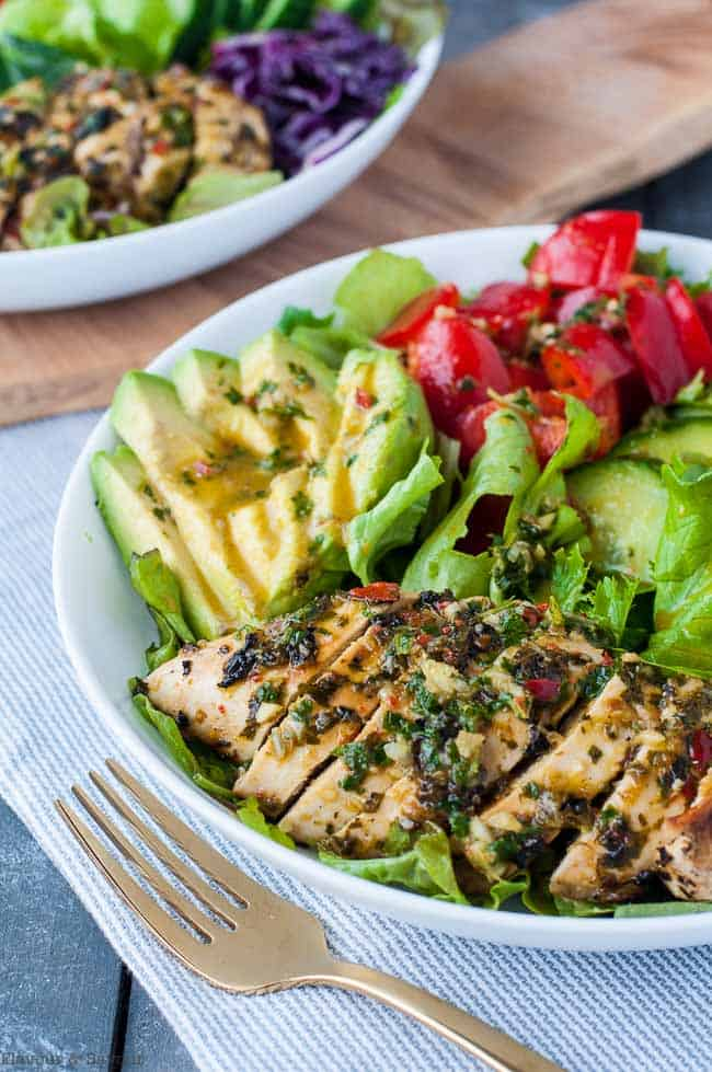 Chimichurri Chicken Dinner Salad with avocado and bell peppers on a bed of greens