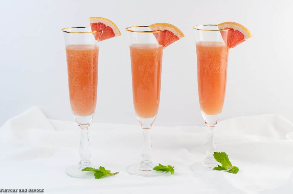 3 champagne glasses of Sugar-Free Grapefruit Ginger Mocktail
