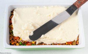 Spreading Cauliflower on Shepherd's Pie with Mashed Cauliflower Crust