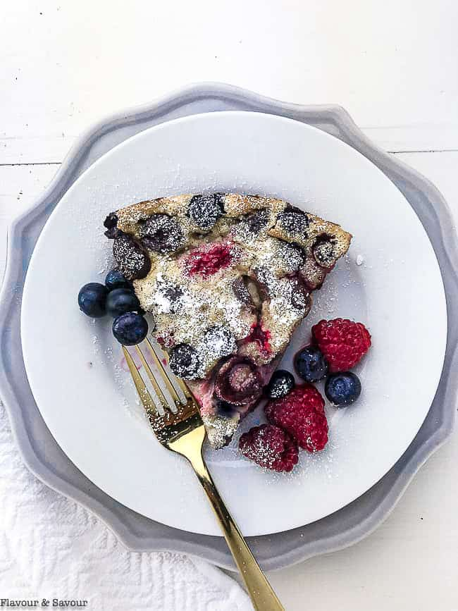 A slice of Cherry Berry Gluten-Free Clafoutis with a fork
