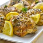 Baked Lemon Chicken with lemon slices and fresh oregano