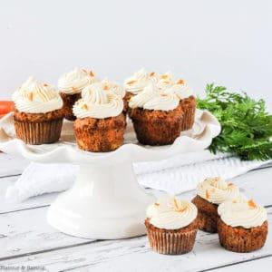Mini gluten-free Carrot Cake Cupcakes on a white pedestal stand.