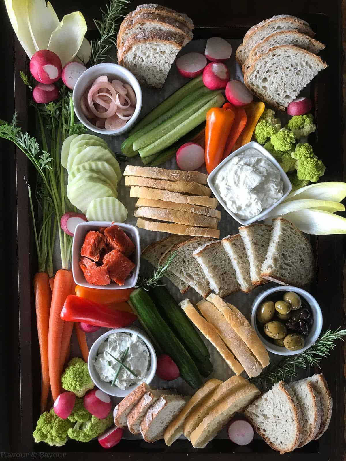 Appetizer Snack Board with veggies, breads, cheese and pickled shallots
