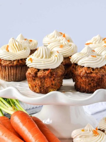 mini Grain-Free Carrot Cake Cupcakes on a pedestal