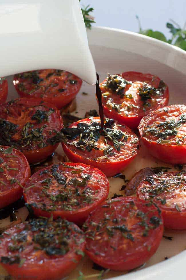 Drizzling balsamic vinegar on Broiled Italian Tomatoes