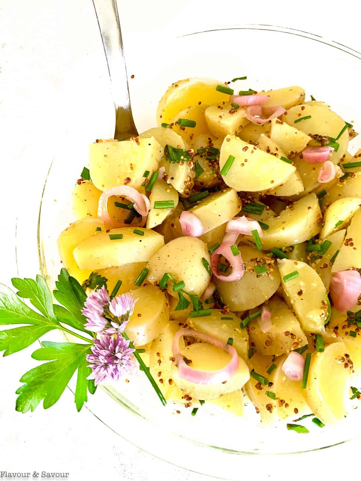 Close up view of Italian potato salad with pickled shallots and snipped chives