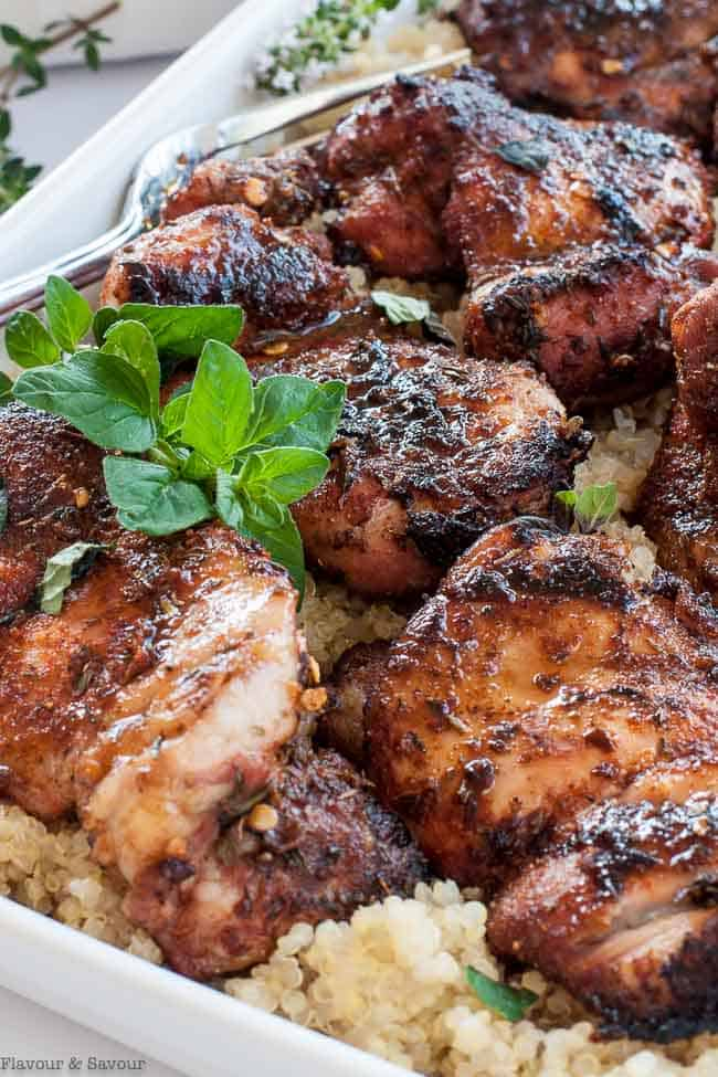 Close up view of Cajun Chicken with a sprig of oregano