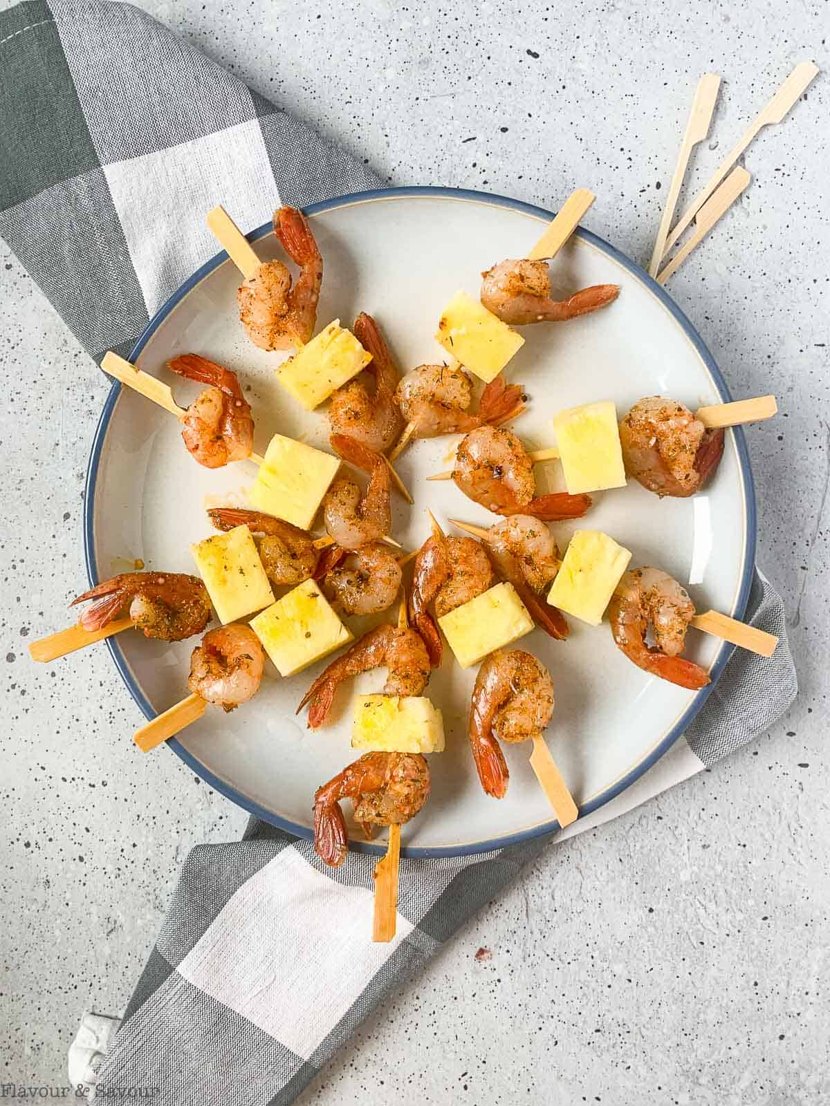Cajun Prawn or Shrimp Kabobs with pineapple ready to grill